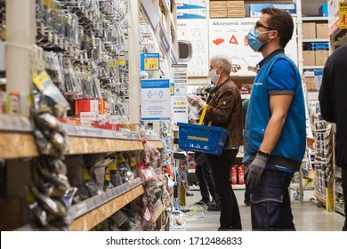 LUBIN, POLAND - APRIL 21, 2020. Customers with face masks due to coronavirus pandemic, in the Castorama building supermarket,