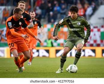 LUBIN, POLAND - APRIL 28, 2016: Match Polish Premer League between KGHM Zaglebie Lubin - Legia Warszawa 2:0. In action Jaroslaw Kubicki (L) and Guilherme Costa Marques (R).