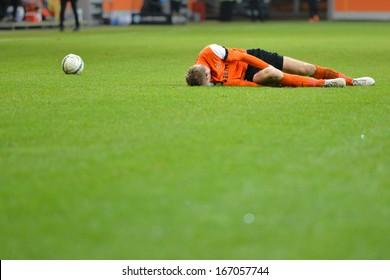 LUBIN, POLAND - DECEMBER 05: Injured Bartosz Rymaniak lying during match Polish Premier League between KGHM Zaglebie Lubin - Podbeskidzie Bielsko-Biala (3:2) on December 05, 2013 in Lubin, Poland.