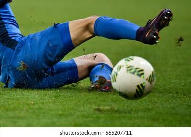 LUBIN, POLAND - DECEMBER 19, 2016: Match Polish Premier League Lotto Ekstraklasa between KGHM Zaglebie Lubin - Piast Gliwice 2:1. Player's legs.