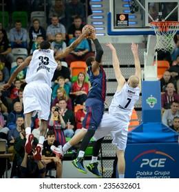 LUBIN, POLAND - DECEMBER 5, 2014: Chris Wright (L), Deshaun Thomas and Damian Kulig (R) in action during the Euroleague basketball match between PGE Turow Zgorzelec - FC Barcelona 65:104.