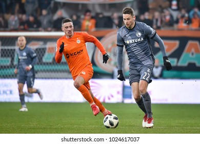LUBIN, POLAND - FEBRUARY 9, 2018: Match Polish Lotto Ekstraklasa  between KGHM Zaglebie Lubin - Legia Warszawa 2:3. In action Filip Jagiello (L) and Kasper Hamalainen (R).