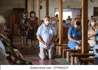 LUBIN, POLAND - JULY 19, 2020. Holy Mass in the Church. Due to the pandemic Covid-19 coronavirus people have face masks.