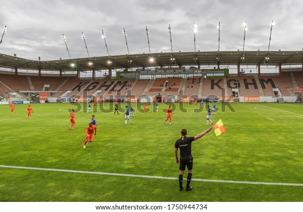 LUBIN, POLAND - JUNE 6, 2020: Match Polish football top league PKO Ekstraklasa between KGHM Zaglebie Lubin vs Lech Poznan. Aerial view on the stadium with no spectators due to Covid-19.