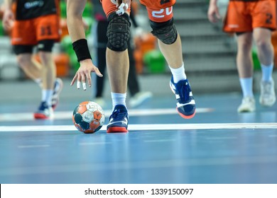 LUBIN, POLAND - MARCH 13, 2019: Polish PGNiG Superleague men in handball match between MKS Zaglebie Lubin - Energa Wybrzeze Gdansk 29:25. Player raises the ball.