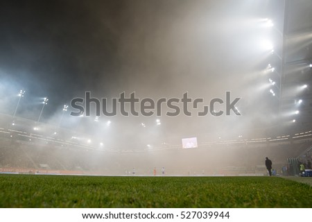 LUBIN, POLAND - NOVEMBER 25, 2016: Match Polish Premier League Lotto Ekstraklasa between KGHM Zaglebie Lubin - Lech Poznan 0:3. Smoke from tribune supporters of Zaglebie.