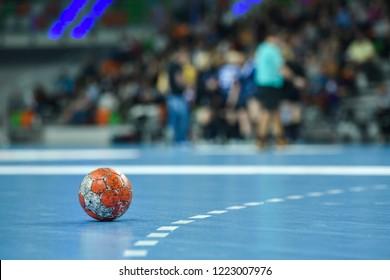LUBIN, POLAND - NOVEMBER 4, 2018:  Handball women Polish PGNiG Superleague match between Metraco Zaglebie Lubin -  MKS Perla Lublin 27:22. Match ball laying on the parquet near 9 m line.