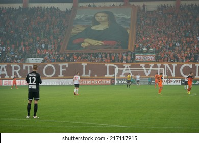 LUBIN, POLAND - SEPTEMBER 12, 2014: Supporters of Zaglebie Lubin with a big picture during match Polish 1 League between KGHM Zaglebie Lubin - Chrobry Glogow (1:0).