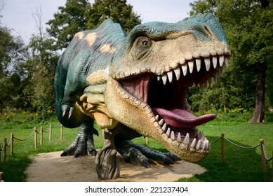LUBIN, POLAND - SEPTEMBER 13, 2014 - Realistic model of dinosaur Tyranosaurus Rex in Park Wroclawski. Park is well known tourist attraction for children in this region of Poland.