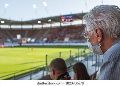 LUBIN, POLAND - SEPTEMBER 20, 2020: Match Polish football top league PKO Ekstraklasa between KGHM Zaglebie Lubin vs Cracovia 1:1. Fan with protective mask due to pandemic Covid-19.