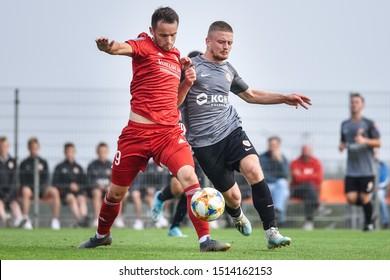 LUBIN, POLAND - SEPTEMBER 24, 2019: 1/32  Polish Cup football match between KGHM Zglebie Lubin II - Miedz Legnica 2:2 (p.1:3) Dawid Kort (L) and Lukasz Soszynski (R).