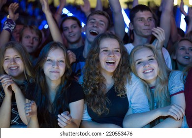 LUBIN, POLAND - SEPTEMBER 26, 2014: Fans during the concert band Dzem in the sports and entertainment hall.