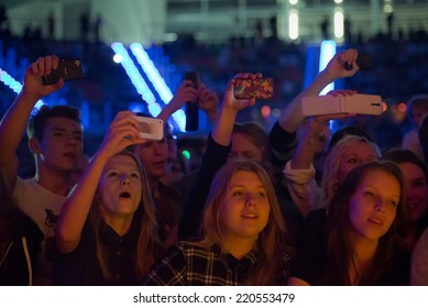 LUBIN, POLAND - SEPTEMBER 26; 2014: Fans during the concert band Dzem in the sports and entertainment hall.