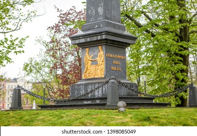 LUBLIN, POLAND - APRIL 29, 2019: Photo of Monument to the Union of Lublin. Bas-reliefs on the obelisk, Poland and Lithuania unite