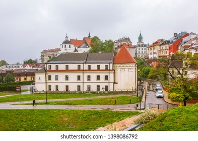 LUBLIN, POLAND - APRIL 29, 2019: Photo of Dominicans monastery and a burning lantern in memory at the Donjon tower of the Lublin castle.