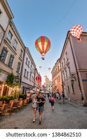 Lublin, Poland - August 10, 2017: Beautiful street and old bright building facades in the old town of Lublin, Poland. Mountebanks Carnaval in Lublin old town.
