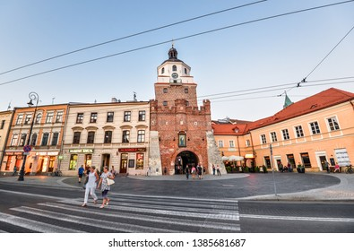 Lublin, Poland - August 10, 2017: Old Cracow gate in Lublin, Poland. Lublin old town city center, Poland. Street and old colorful buildings in the old town of Lublin.