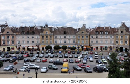 LUBLIN, POLAND - AUGUST 9: Parking in Lublin Old Town, view at historic buildings on August 9, 2011 in Lublin, Poland.