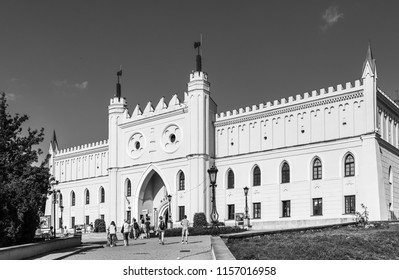 Lublin, Poland - Jul 27, 2018: Black and white image of Royal Castle of Lublin, bridge with tourists. The Lublin Castle is a medieval castle in Lublin adjacent to the Old Town district