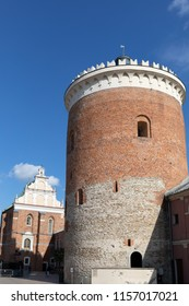 Lublin, Poland - Jul 27, 2018: Tower of Royal Castle of Lublin against bright blue sky. The Lublin Castle is a medieval castle in Lublin adjacent to the Old Town district and close to the city center