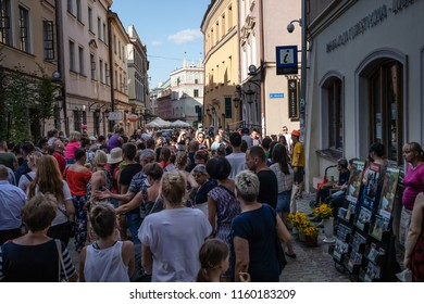 Lublin, Poland - Jul 27, 2018: Crowds of tourists and holidaymakers on the streets of the old city of Lublin. Lublin is the ninth largest city in Poland