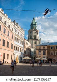 LUBLIN, POLAND - JULY 27, 2018: Rope walkers at urban highline festival placed in city space of Lublin. Lublin is one of the biggest cities in Poland.