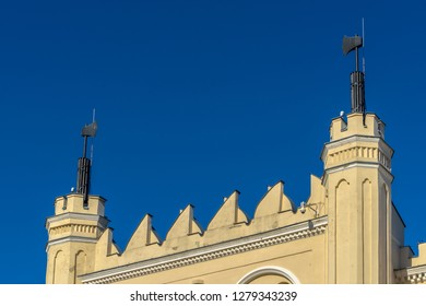 LUBLIN, POLAND - Juni 07, 2018: The main entrance gate detail of the Neo-Gothic part of the Lublin Castle with axes. The medieval royal castle is in city center.