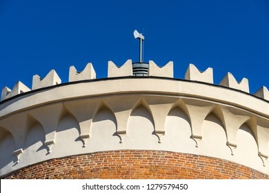 LUBLIN, POLAND - Juni 07, 2018: The top of the Lublin Castle tower (donjon) with an ax. It is monument of Romanesque art belonging to Royal Castle complex and one of oldest buildings in the region