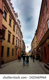 Lublin, Poland - May 14, 2019: The narrow streets of the old city of Lublin, which tourists are walking slowly.