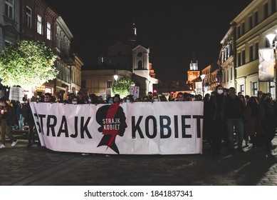 Lublin, Poland - October 23, 2020: People walking the city centre during protest (Pogrzeb Praw Kobiet) organized by Strajk Kobiet against abortion ban in Poland
