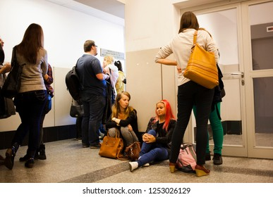 Lublin Poland - October 6, 2014: Students before the lecture are waiting for the teacher to come in the corridor of the Catholic University of Lublin