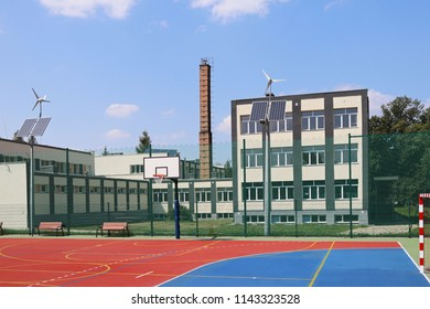 Lubno, Poland - july 9 2018:An open stadium in the courtyard of a village school. Eduction of the younger generation. Sports ground for football, volleyball and basketball. Lighting on natural sources
