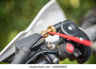 Lubricating motorcycle braking cables with dedicated chain spray grease.