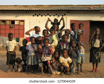 Lubumbashi, Democratic Republic of Congo, circa May 2006: Group of children posing for the camera in the yard of an abandoned factory