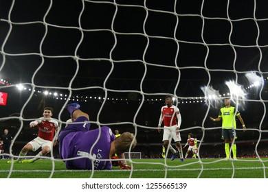 Lucas Torreira of Arsenal (left) celebrates after scoring the opening goal - Arsenal v Huddersfield Town, Premier League, Emirates Stadium, London (Holloway) - 8th December 2018