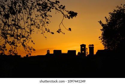 Lucca golden sunset skyline with ancient medieval towers