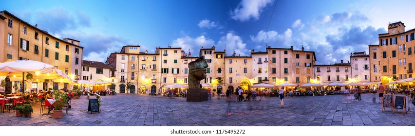 LUCCA, ITALY - 13 SEPTEMBER, 2017: Famous Piazza Anfiteatro in Lucca, Italy on 13 September, 2017. The square is a public square in the northeast quadrant of walled center of Lucca, Italy.