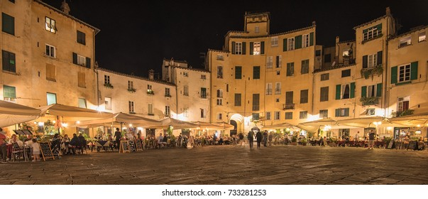 LUCCA, ITALY - 14 SEPTEMBER, 2017. Restaurant with people at night in Lucca, Italy on 14 September, 2017.