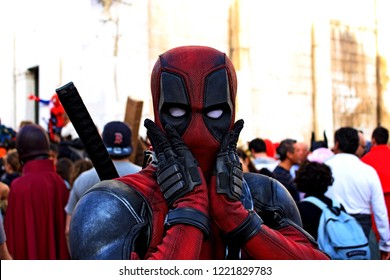 Lucca, Italy 3 November 2018: boy masked by the superhero Deadpool at Lucca Comics & Games