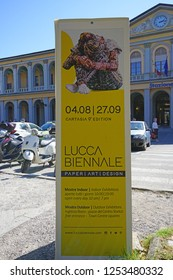 LUCCA, ITALY -30 SEP 2018- View of a sign for the 2018 Lucca Biennale d'Arte, an art festival dedicated to paper architecture, in Lucca, a historic city in Tuscany, Central Italy.