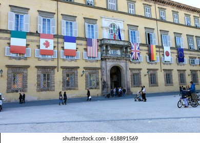 Lucca, Italy - April 09, 2017: The facade of the Ducal Palace in Lucca with the flags of the nations that take part at the G7 Foreign Affairs Ministers 2017