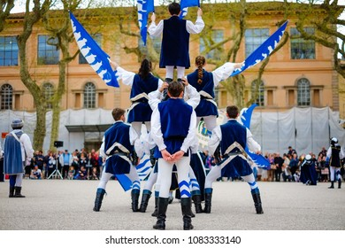 Lucca, Italy - April 25, 2018: Flag throwing during medieval festival in the historic city of Lucca in Tuscany region of Italy