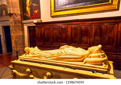 LUCCA, ITALY - APRIL 30, 2013: The marble tombstone and monument of Ilaria del Carretto, made by sculptor Jacopo della Quercia, located in Lucca Cathedral, on April 30 in Lucca