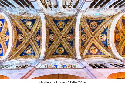 LUCCA, ITALY - APRIL 30, 2013: The beautiful frescoes on the central arched vault of Saint Martin Cathedral, on April 30 in Lucca