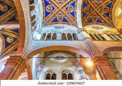 LUCCA, ITALY - APRIL 30, 2013: Lucca Cathedral boasts modest interior in gothic style with beautiful frescoes on its vaults, on April 30 in Lucca