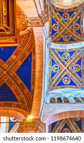 LUCCA, ITALY - APRIL 30, 2013: The bright frescoes on the vaults of Cathedral complement the modest gothic style interior, on April 30 in Lucca
