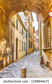 LUCCA, ITALY - APRIL 30, 2013: The narrow medieval street in the heart of old town of Lucca, on April 30 in Lucca