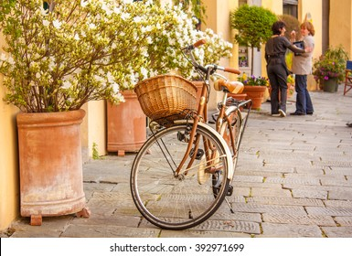 Lucca, Italy - August 2012: Lucca is a beautiful small city in Toscany, Italy. Here life goes in a different speed and bicicles are the main way of transportation.