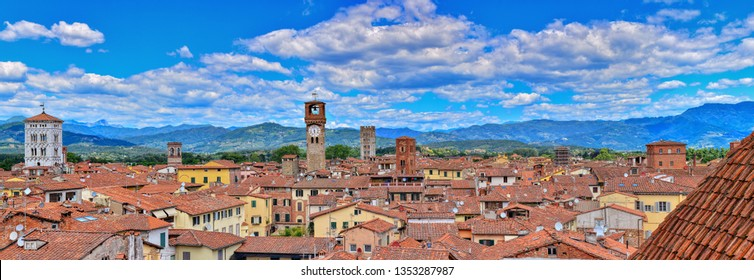 Lucca, Italy - June 26,2018: Beautiful medieval town Lucca in Tuscany. Houses with red roofs.
