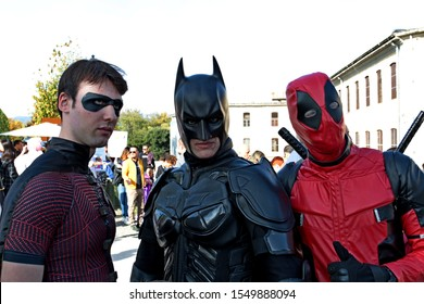 Lucca, Italy - November 1, 2019: cosplay at the Lucca Comics masked by Batman & Robin and Deadpool